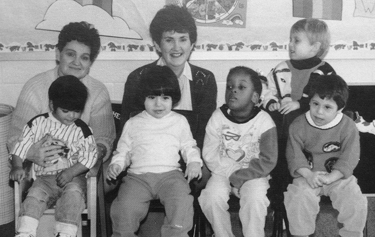 Black and white photograph from Forestdale's 1990 to 1991 yearbook showing the pre-school class. Five students and two teachers are pictured.